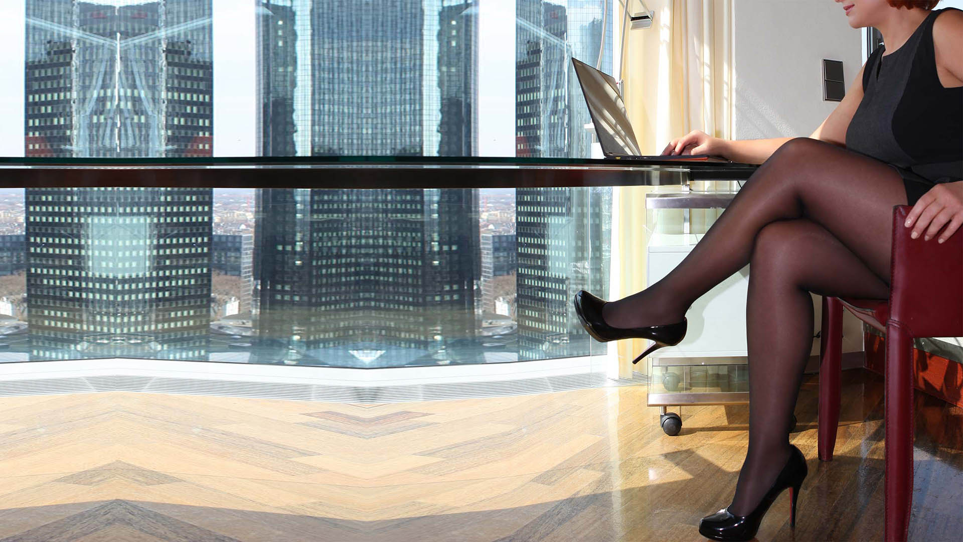 Sofia businesswoman and VIP Escort Independent in Louboutin high heels at work