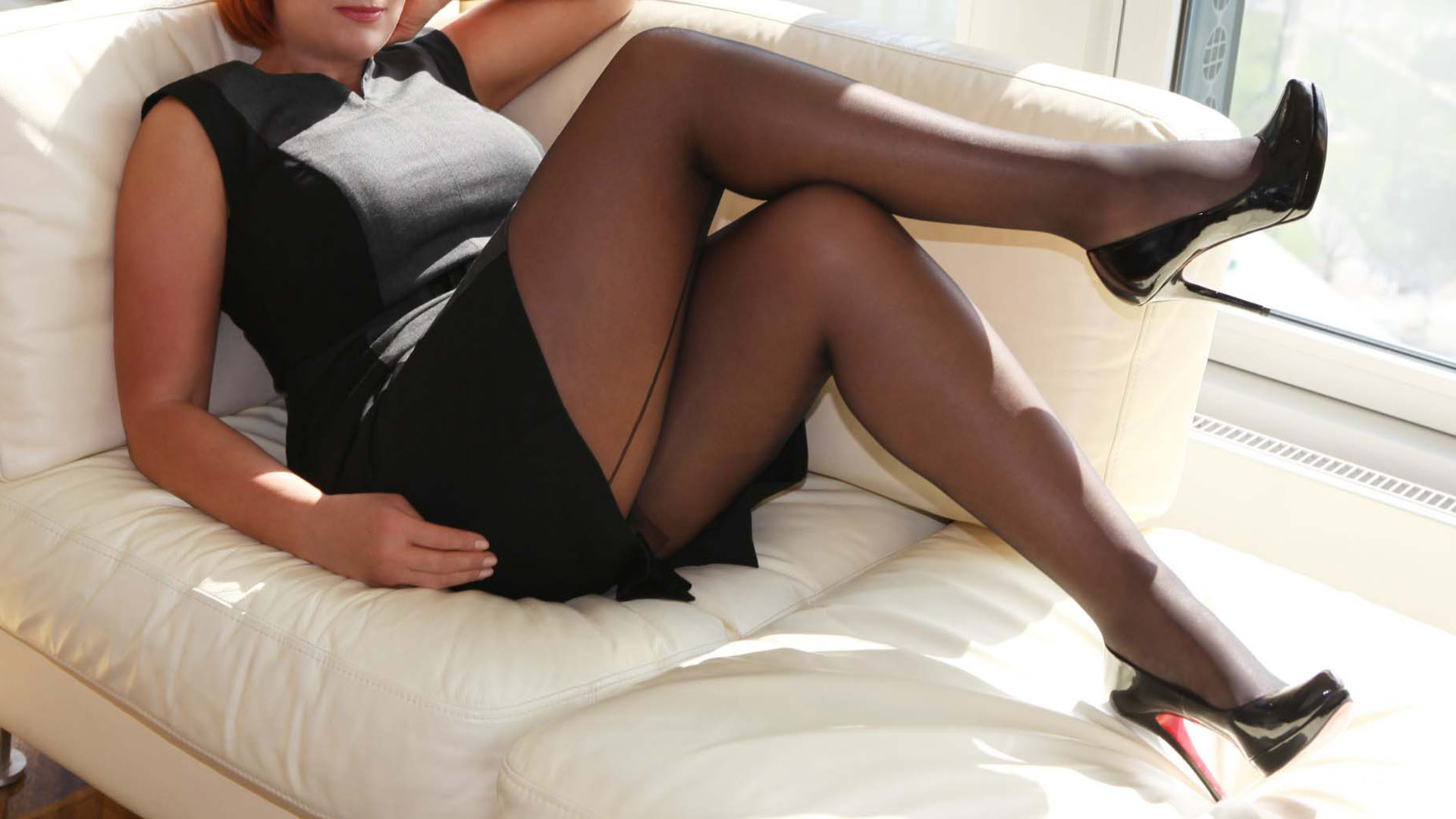 Sofia businesswoman and VIP luxury courtesan in Louboutin high heels lying on the couch during the break
